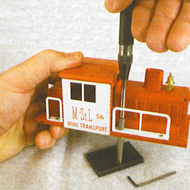 "Tightening handrails on a motorized unit using the Original Riveter with tip BRT2-1 and BR1-P1 Backing Stake. Note the BREXT-1,1"" extension for the Original Riveter, which allows the body of the Original Riveter to stay safely away from the engine cab."