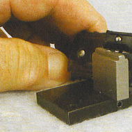 Note the special backing stake BR1-P3 for acces?sory car slide shoes. This stake allows the head of the rivet to be held firmly in the seat of the slide shoe during the installation and rivet operation. Note also the beveled ends for the #TT-208 Slide Shoe. That modification to the slide shoe is covered in Backshop Run 218 for hi-rail track and switches.