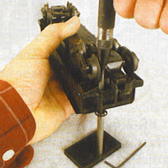 Here's another easy job to do with the Original Riveter. You can tighten brake wheels and their base shaft at the same time on Lionel dump cars using the BRT1-1 Tip with the BR1-P1 Backing Stake.